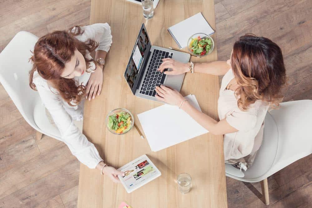 women working on a desk